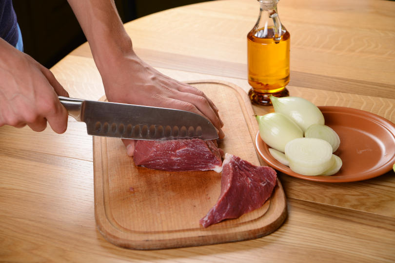 Beef steak, Pieces of raw meat with steak knife on a kitchen table