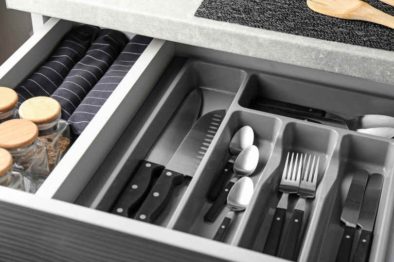 Set of cutlery in kitchen drawer