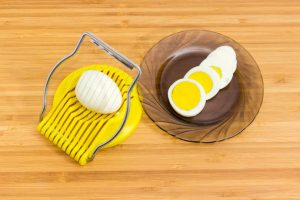 Egg slicer and sliced boiled egg
