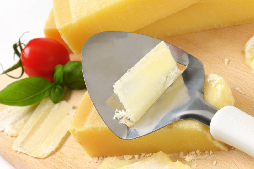 Slicing cheese with a cheese slicer