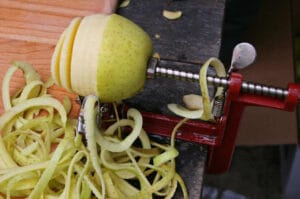 Apple Peeler with Half-Peeled Apple