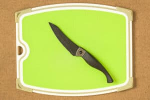 Rubber cutting board and knife on a wooden board