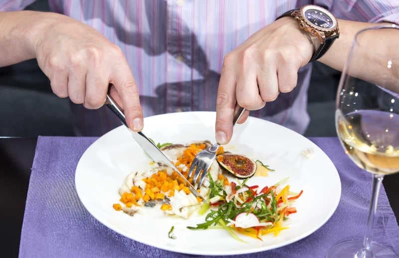 Man having dinner with dinner knife and fork