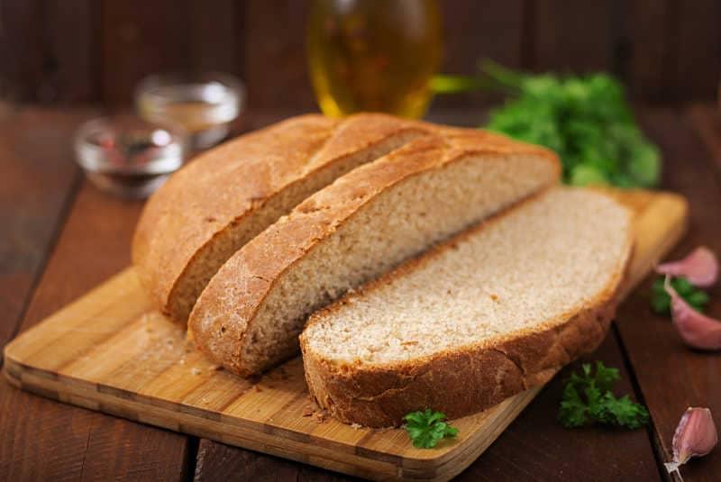 Homemade bread sliced on a board