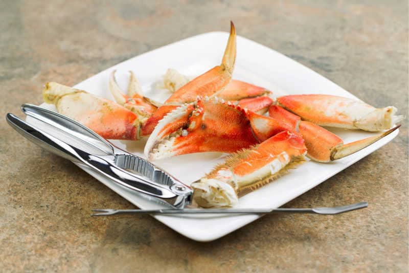 Large Crab Claw and Lobster Cracker on a Plate