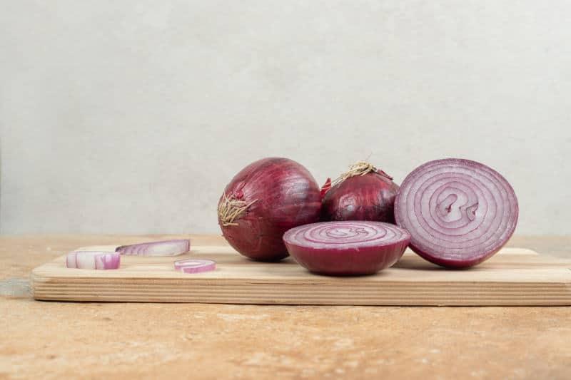 Sliced onion on a wooden cutting board